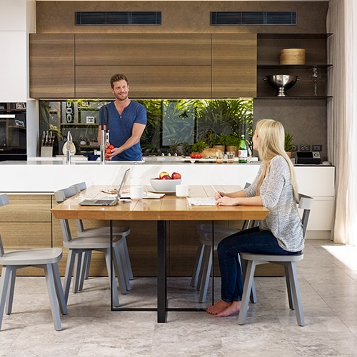 Daikin Ducted Lifestyle couple in kitchen dining