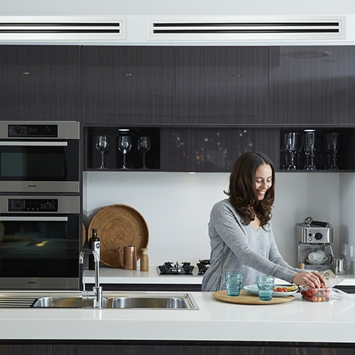 Daikin Ducted Lifestyle woman in kitchen